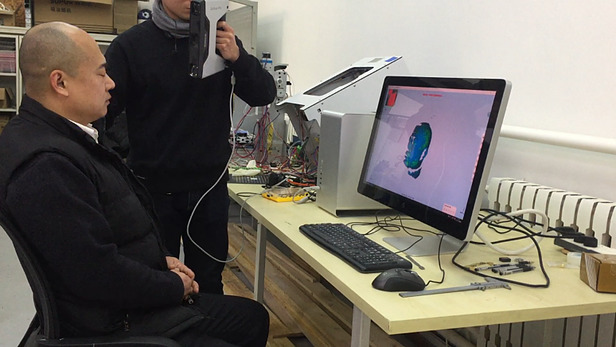 The engineer at Prod-lab used handheld 3D scanner EinScan-Pro to scan the human's head.